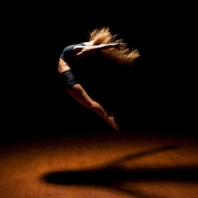 """""""Beautiful dancer jumping in a stage"""" stock image"""