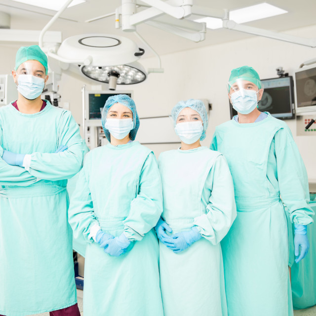 """""""Group of surgeons in an OR"""" stock image"""