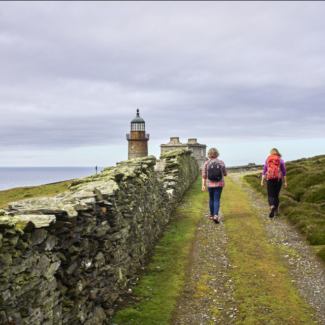 """""""Two women walkers on the Calf of Man"""" stock image"""
