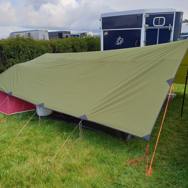 """""""Camping at Aintree Racecourse with tarp awning, October 2019"""" stock image"""