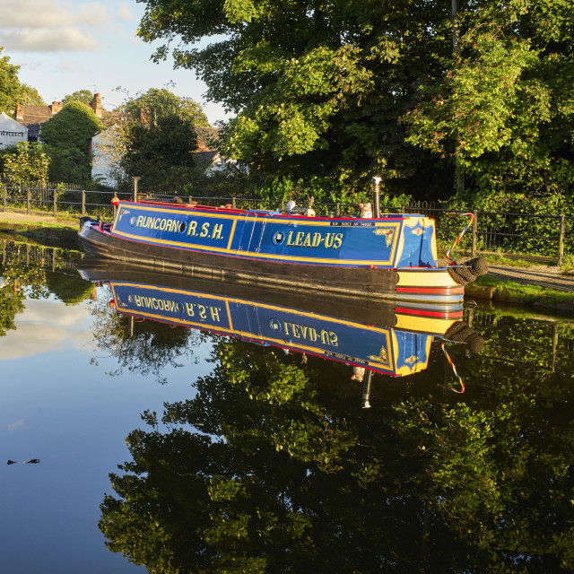 """""""Attractively painted narrowboat"""" stock image"""
