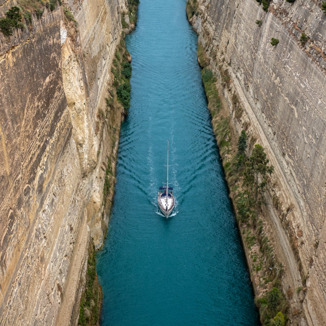 """""""Sailboat navigating the Corinth Canal in Greece."""" stock image"""