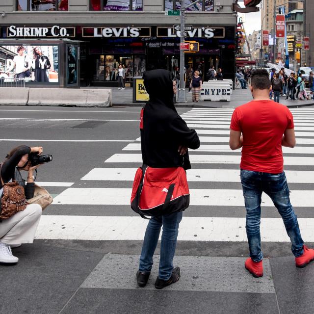 """Photographer taking street photos in New York"" stock image"