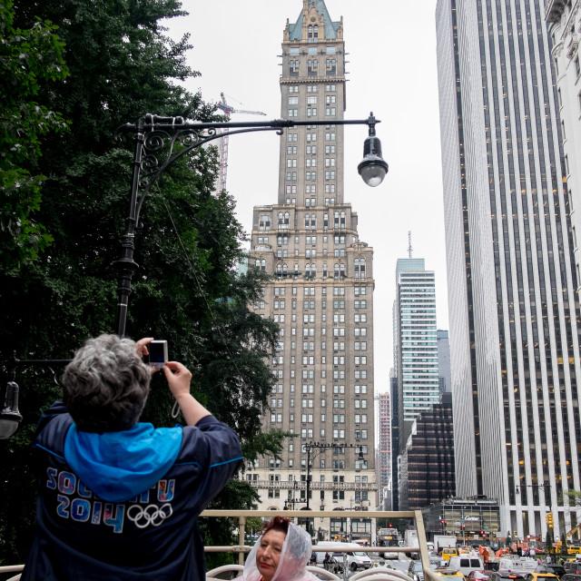 """Tourist taking photo in New York"" stock image"