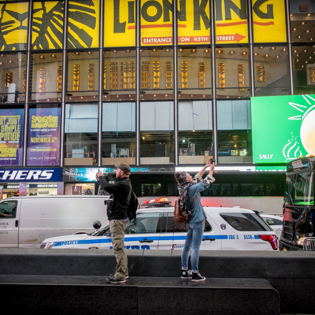 """""""Tourists taking photos, Times Square, New York."""" stock image"""