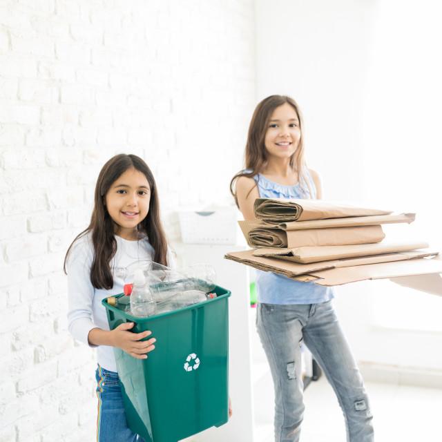 """""""Confident Girls Organizing Waste"""" stock image"""