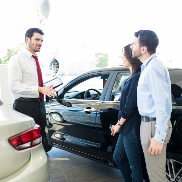 """""""Couple Listening To Car Salesman With Trust"""" stock image"""