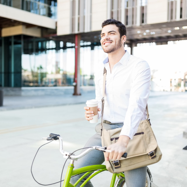 """""""Smiling Executive With Coffee And Cycle On Street"""" stock image"""