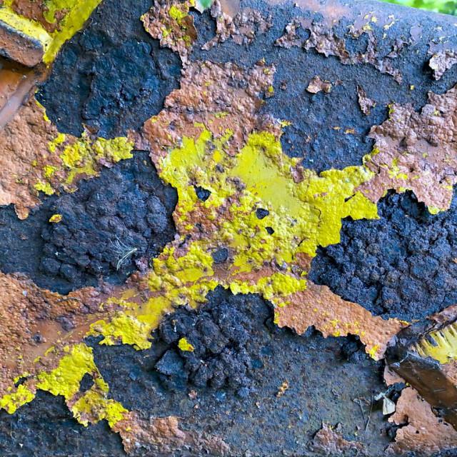 """Flaking paint on farm machinery"" stock image"