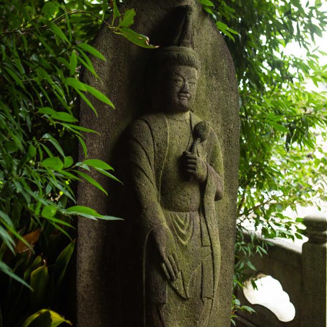"""Kuan Yin statue outside of Sengakuji Temple, Minato, Tokyo, Japan"" stock image"