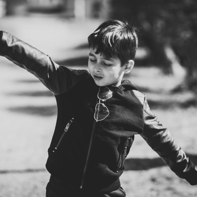 """Boy playing airplane"" stock image"
