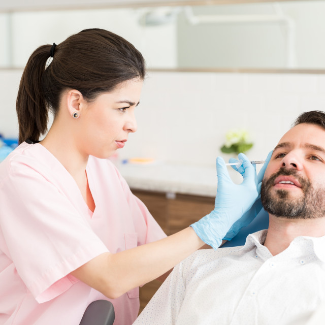 """""""Man Taking Pain To Improve Appearance"""" stock image"""