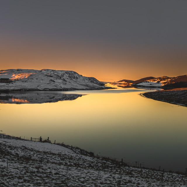 """Sunrise over a Shetland voe"" stock image"