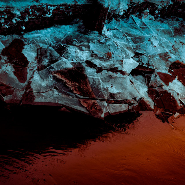 """""""""""Ice And Fire"""" - Artistic abstract of broken ice and red water"""" stock image"""