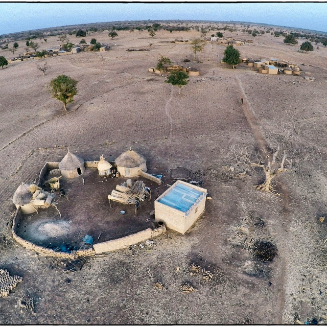 """Drone shot of village in Burkina Faso"" stock image"