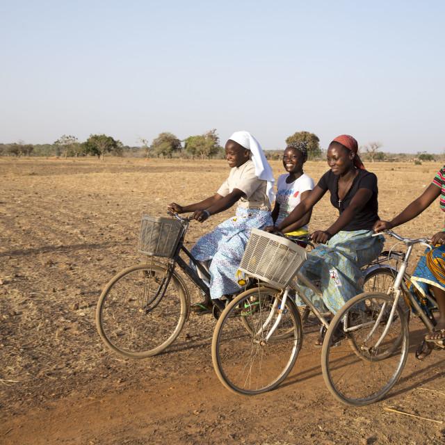 """Catholic Sisters on bike tour in Burkina Faso"" stock image"