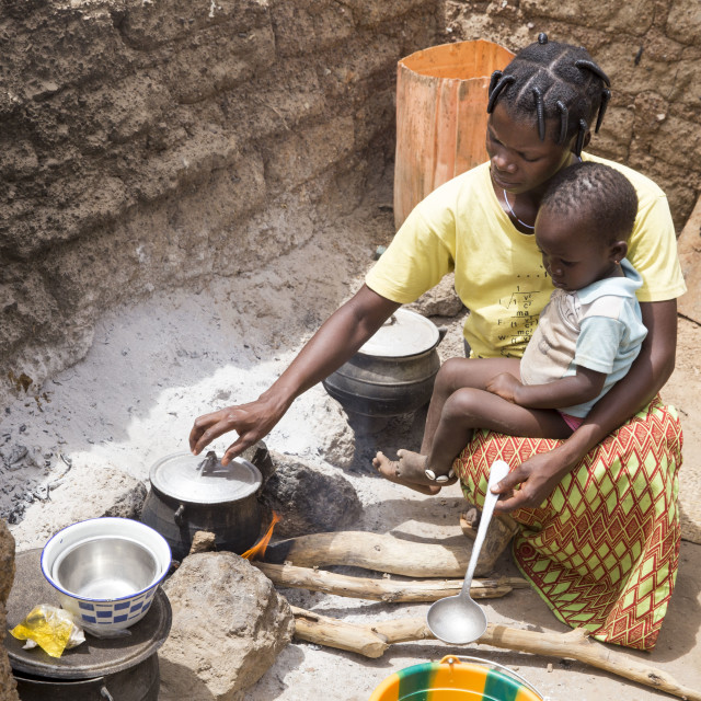 """Mother cooking in Burkina Faso"" stock image"