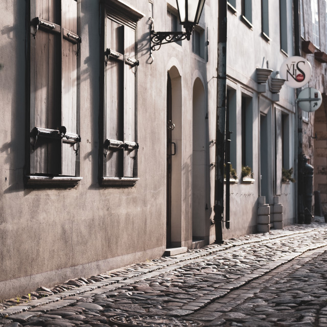 """Cobblestone street in the historic Riga, Latvia Old City"" stock image"