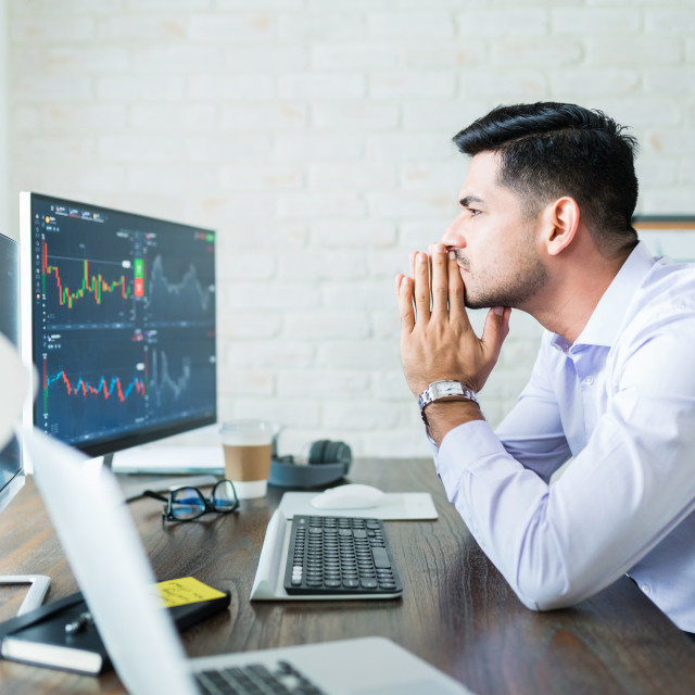 """""""Attractive Male Finance Professional Concentrating On Trading"""" stock image"""