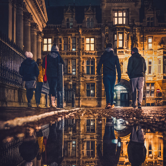 """""""Night reflections of Gonville & Caius College, University of Cambridge."""" stock image"""