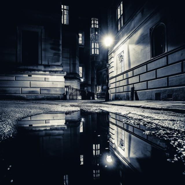 """Black and White night reflections from Trinity Lane, Cambridge UK."" stock image"