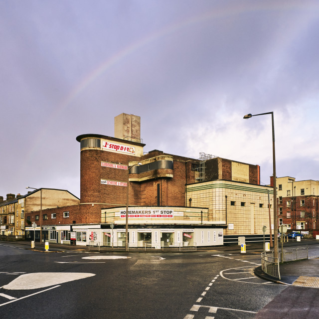 """""""A rainbow arched over the 1930s Odeon"""" stock image"""