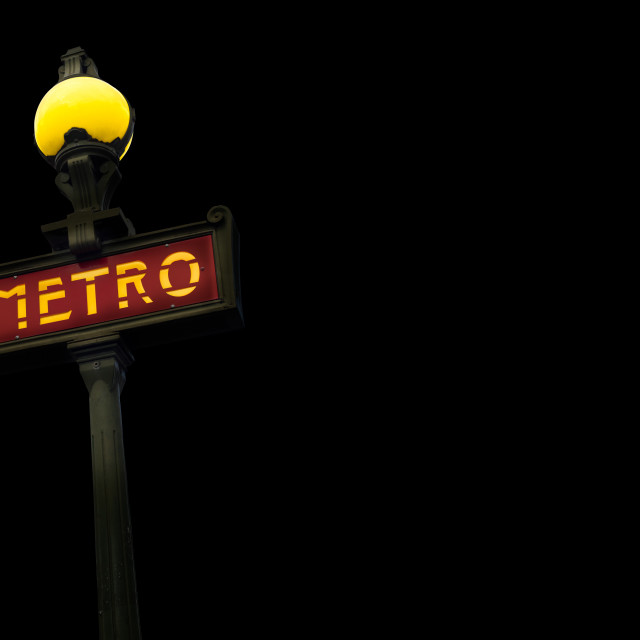 """Vintage Metro Sign At Night"" stock image"