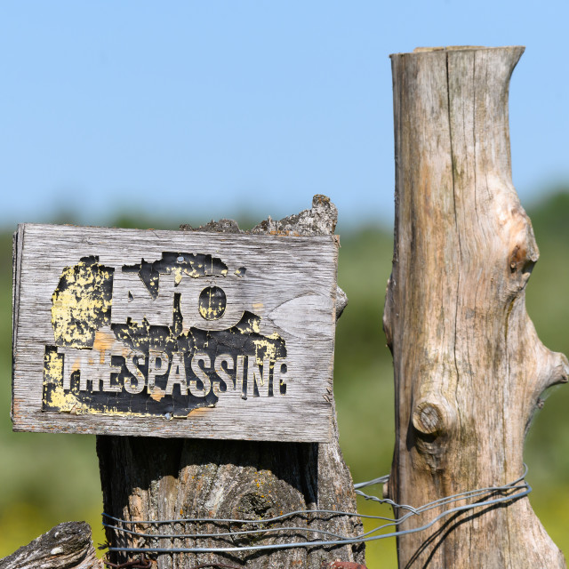 """Weathered No Trespassing Sign"" stock image"