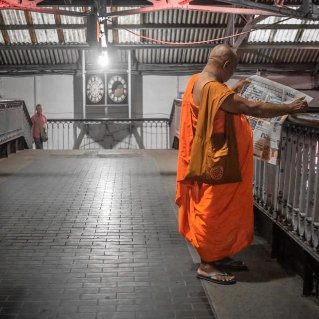 """Buddhist monk & news"" stock image"