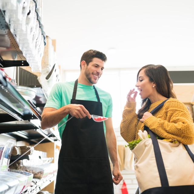 """Female Customer Shopping In Supermarket"" stock image"