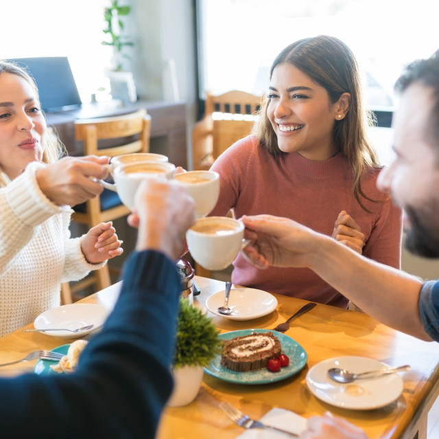 """""""Happy Friends Celebrating At Cafe"""" stock image"""