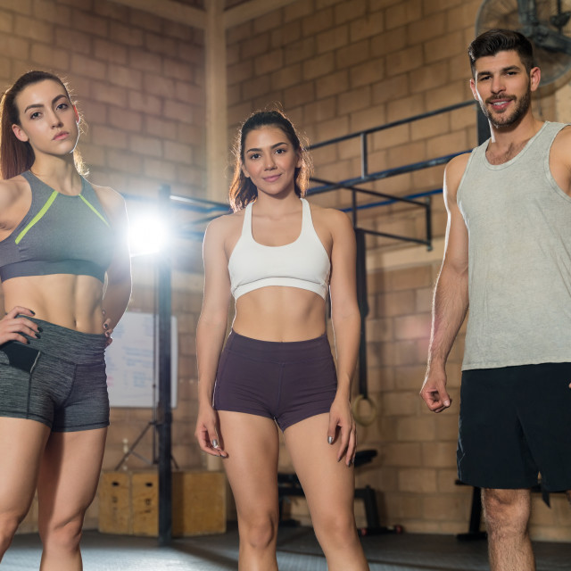 """""""Portrait Of Friends Standing At Gym"""" stock image"""