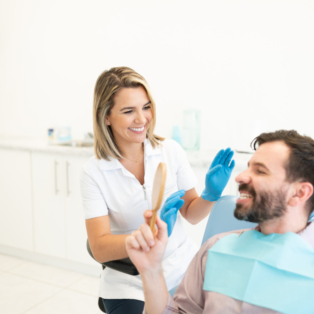 """""""Smiling Dentist With Patient At Clinic"""" stock image"""