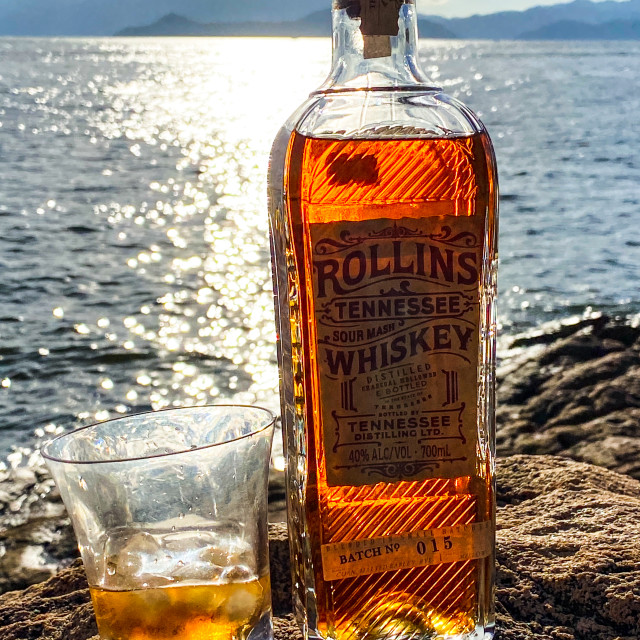 """""""Rollins Whiskey against a summer sea"""" stock image"""