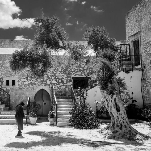 """Nun and old tree, Crete"" stock image"