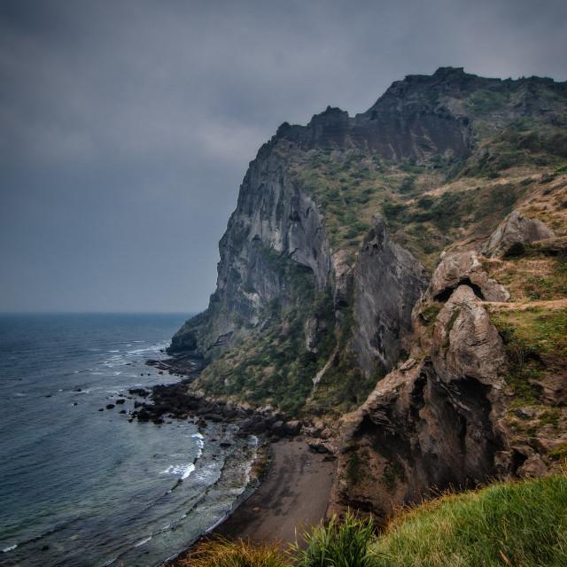 """Coastal cliffs, Jeju, South Korea"" stock image"