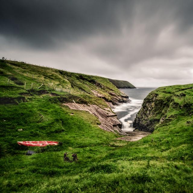 """Bay and boat, Ireland"" stock image"