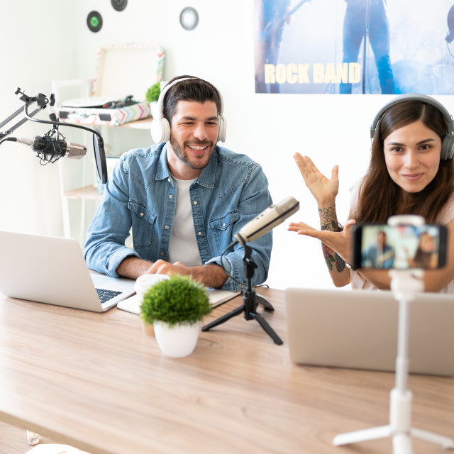 """""""Announcer introducing her podcast guest"""" stock image"""