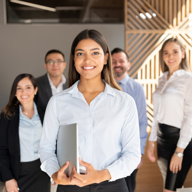 """""""Confident hispanic business woman in office"""" stock image"""