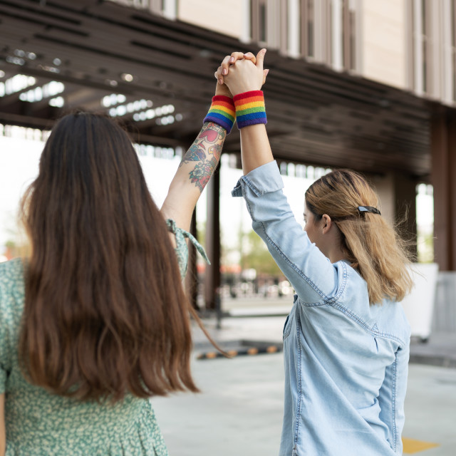 """""""Gay young couple supporting LGBT rights"""" stock image"""