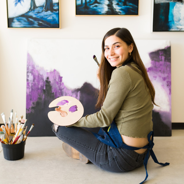 """""""Happy female artist doing a big painting for an art exhibition"""" stock image"""