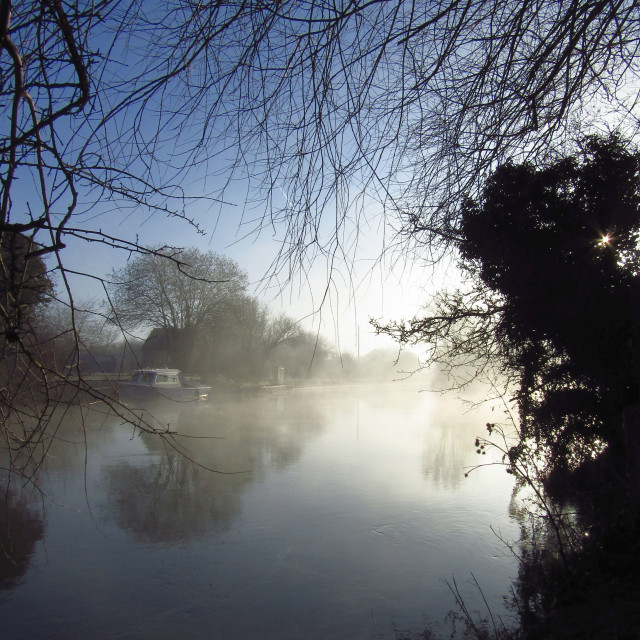 """Tranquil misty morning on the Oxfordshire Thames"" stock image"