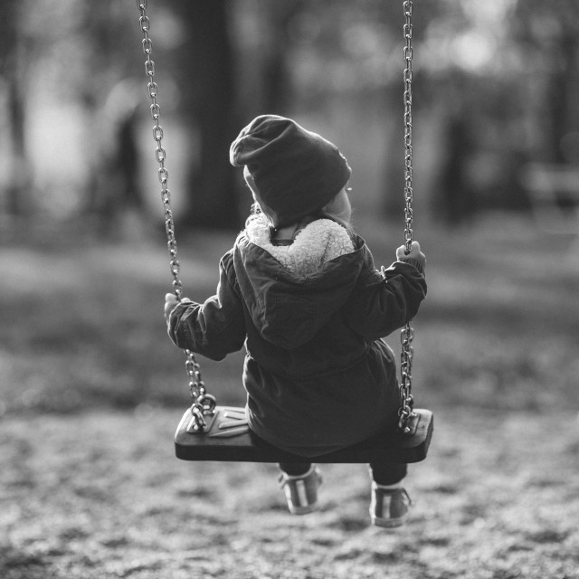 """""""child on a swing, black and white"""" stock image"""