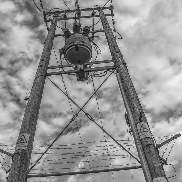 """Electricity Pylon - Black & White"" stock image"