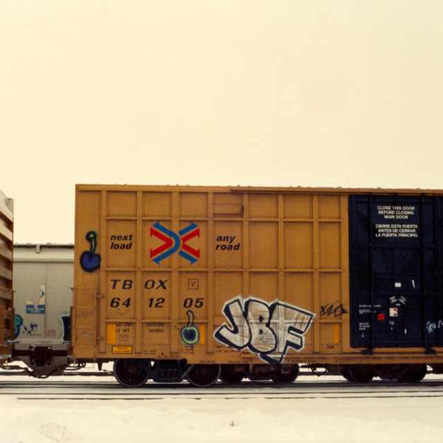 """""""Graffitied Train Car in the Winter"""" stock image"""