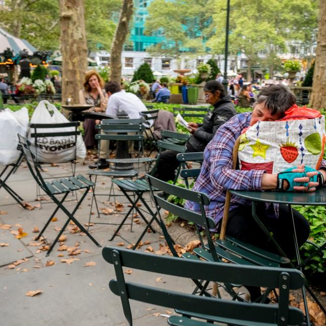 """Women sleeping in Bryant Park Manhattan."" stock image"