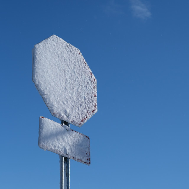 """""""Stop sign coated in snow"""" stock image"""