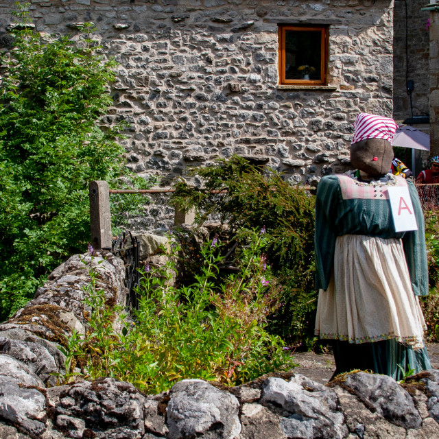 """""""Kettlewell Scarecrow Festival and Trail, Scarecrow in Garden. Yorkshire Dales, England."""" stock image"""