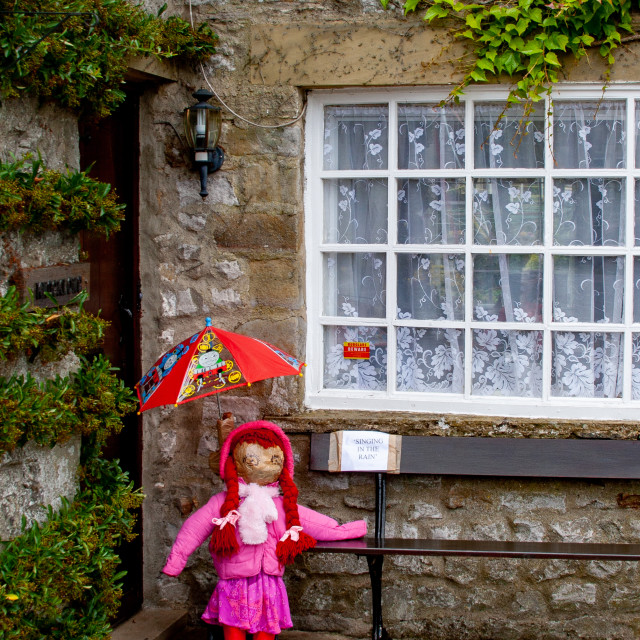 """""""Kettlewell Scarecrow Festival and Trail, Singing in the Rain. Yorkshire Dales, England."""" stock image"""