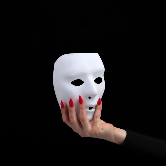 """""""Mask is a symbol of duplicity removable after work in corporations"""" stock image"""